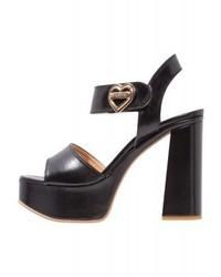 Sandali con tacco in pelle neri di Moschino