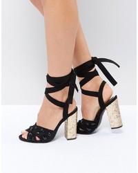 Sandali con tacco in pelle scamosciata decorati neri di Truffle Collection