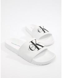 Sandali di gomma bianchi e neri di Calvin Klein