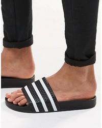 Sandali neri di adidas