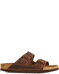 Sandali piatti in pelle marrone scuro di Birkenstock