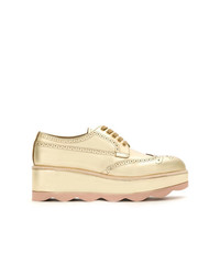 Scarpe oxford in pelle dorate di Prada