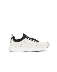 Scarpe sportive bianche e nere di Apl