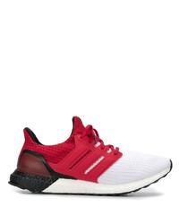 Scarpe sportive rosse e bianche di adidas
