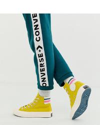 Sneakers alte di tela gialle di Converse