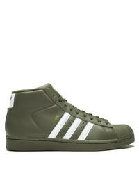 Sneakers alte in pelle verde oliva di adidas