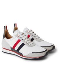 Sneakers basse bianche di Thom Browne