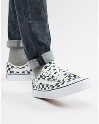 Sneakers basse di tela a quadri bianche