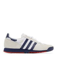Sneakers basse di tela bianche e blu scuro