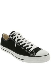 Sneakers basse di tela nere e bianche