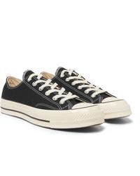 Sneakers basse di tela nere e bianche di Converse