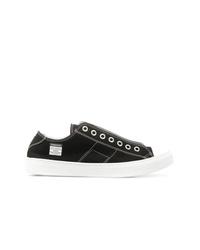 Sneakers basse di tela nere e bianche di Maison Margiela