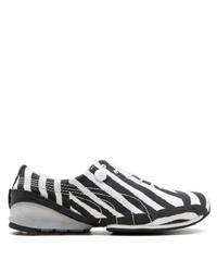 Sneakers basse di tela nere e bianche di Puma