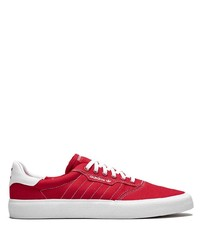 Sneakers basse di tela rosse di adidas