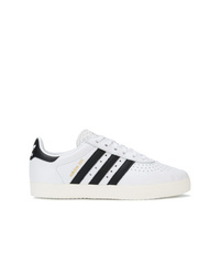 Sneakers basse in pelle bianche e nere di adidas