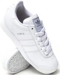 Sneakers basse in pelle bianche