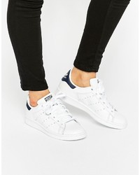 Sneakers basse in pelle bianche di adidas