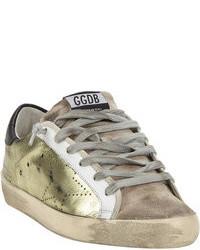 Sneakers basse in pelle dorate