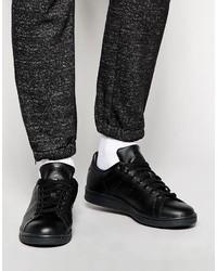 Sneakers basse in pelle nere di adidas