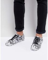 Sneakers basse in pelle stampate bianche e nere