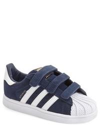 Sneakers blu scuro e bianche