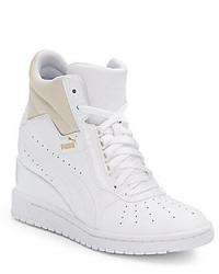 Sneakers con zeppa in pelle bianche