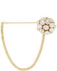 Spilla dorata di Dolce & Gabbana