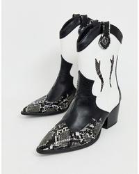 Stivali neri e bianchi da donna | Outfit donna | Lookastic