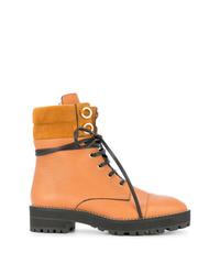 Stivali piatti stringati in pelle arancioni di Stuart Weitzman