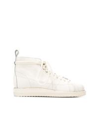 Stivali piatti stringati in pelle bianchi di adidas