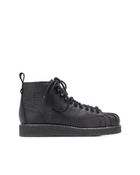 Stivali piatti stringati in pelle neri di adidas