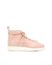 Stivali piatti stringati in pelle rosa di adidas