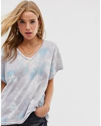 T-shirt con scollo a v effetto tie-dye grigia di Free People