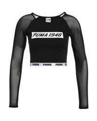 Top corto stampato nero di Puma
