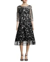 Vestito longuette in rete ricamato nero